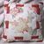 Floral print center pillow with patchwork red, pink, and floral border