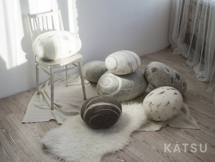 Felt stone poufs or pillows.  Made of soft natural wool. Like real rocks. KATSU