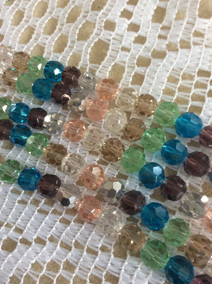 8 inch strand of 8mm faceted glass crystal beads in a 'Winter mix' color scheme