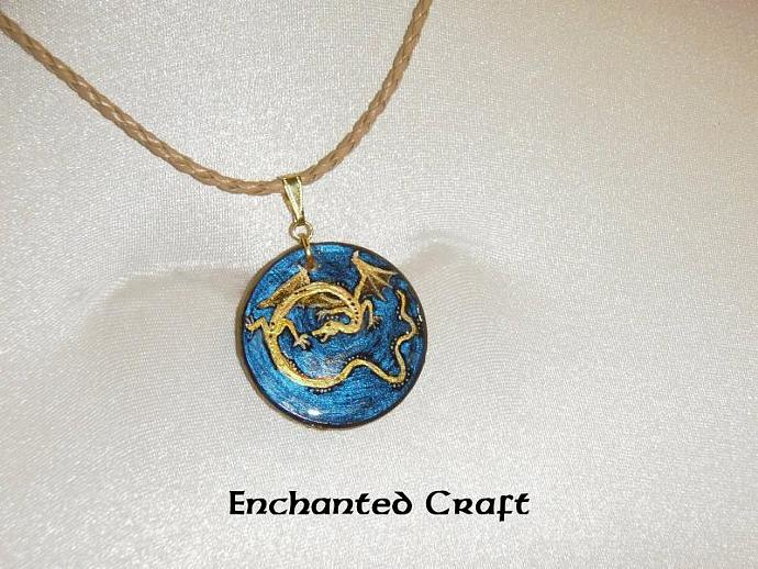 Gold dragon wood pendant on blue background- with gold bail and faux leather