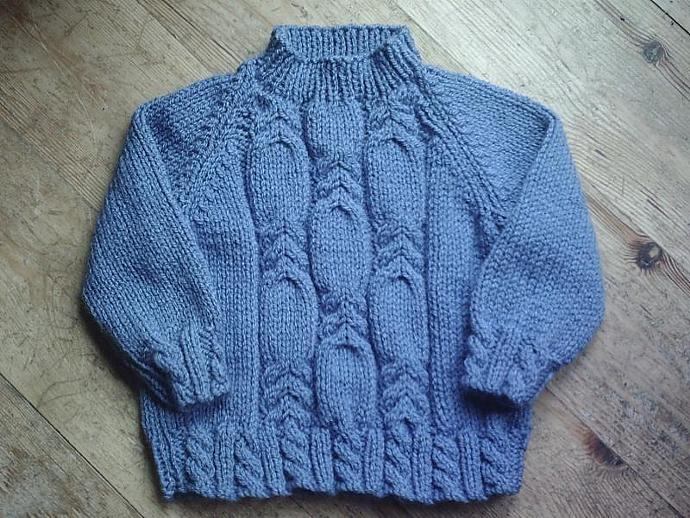 Cosy handknit cabled aran sweater