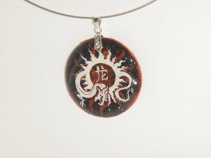 Royal dragon wood pendant on red and black background