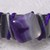 Metal band bracelet with natural purple and white stone, purple cording, gray