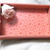 Deep pink color tray with laminated heart patterned paper and a silk rose