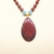 Fire agate pendant necklace with jasper and blue jade with antiqued gold beads