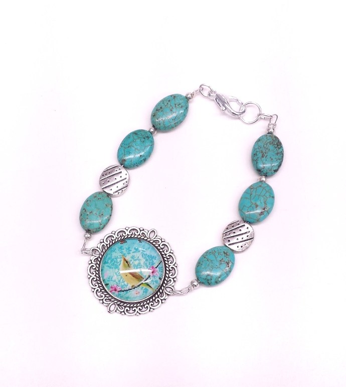 Turquoise art bracelet with turquoise howlite in an an ornate antiqued silver