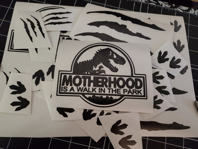 Motherhood is a walk in the park, dinosaur footprints and claw marks vinyl
