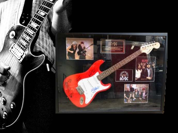 AC DC Malcolm & Angus Young signed and framed electric guitar