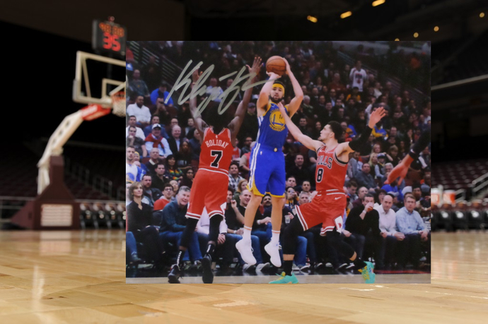 Klay Thompson Golden State Warriors 8 by 10 signed photo
