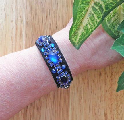 Victorian or goth style glowing cobalt and capri blue rhinestones on black