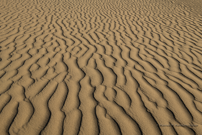 Abstract sand dune ripples create at Death Valley, California.  Image shows