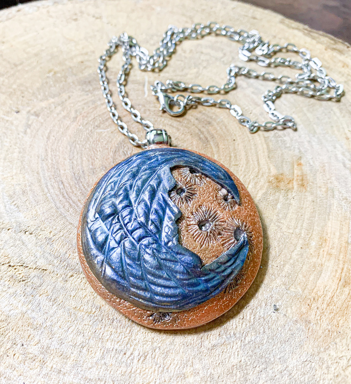 Man in the Moon Pendant on a Silver Chain