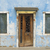 Weathered doors and windows along the waterfront at Burano, a lovely island near