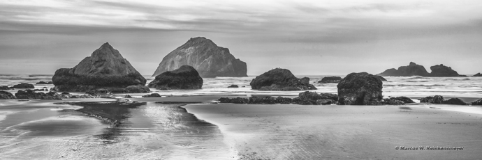 Dramatic rock formations in Pacific Ocean waters. Bandon Beach. Panoramic shows