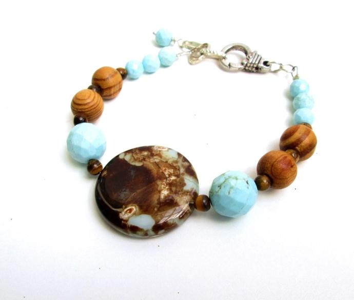 Jade, tiger's eye and wood bracelet, mottled blue and brown jade focal bead.