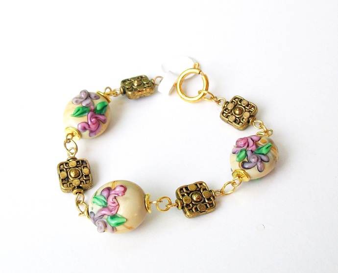 Pastel floral bracelet with handcrafted lampwork beads and antiqued gold beads,