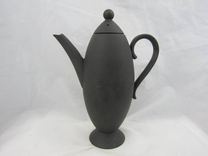Nick Munro Coffee pot with cup and saucer. Black bullet-shaped coffee pot with