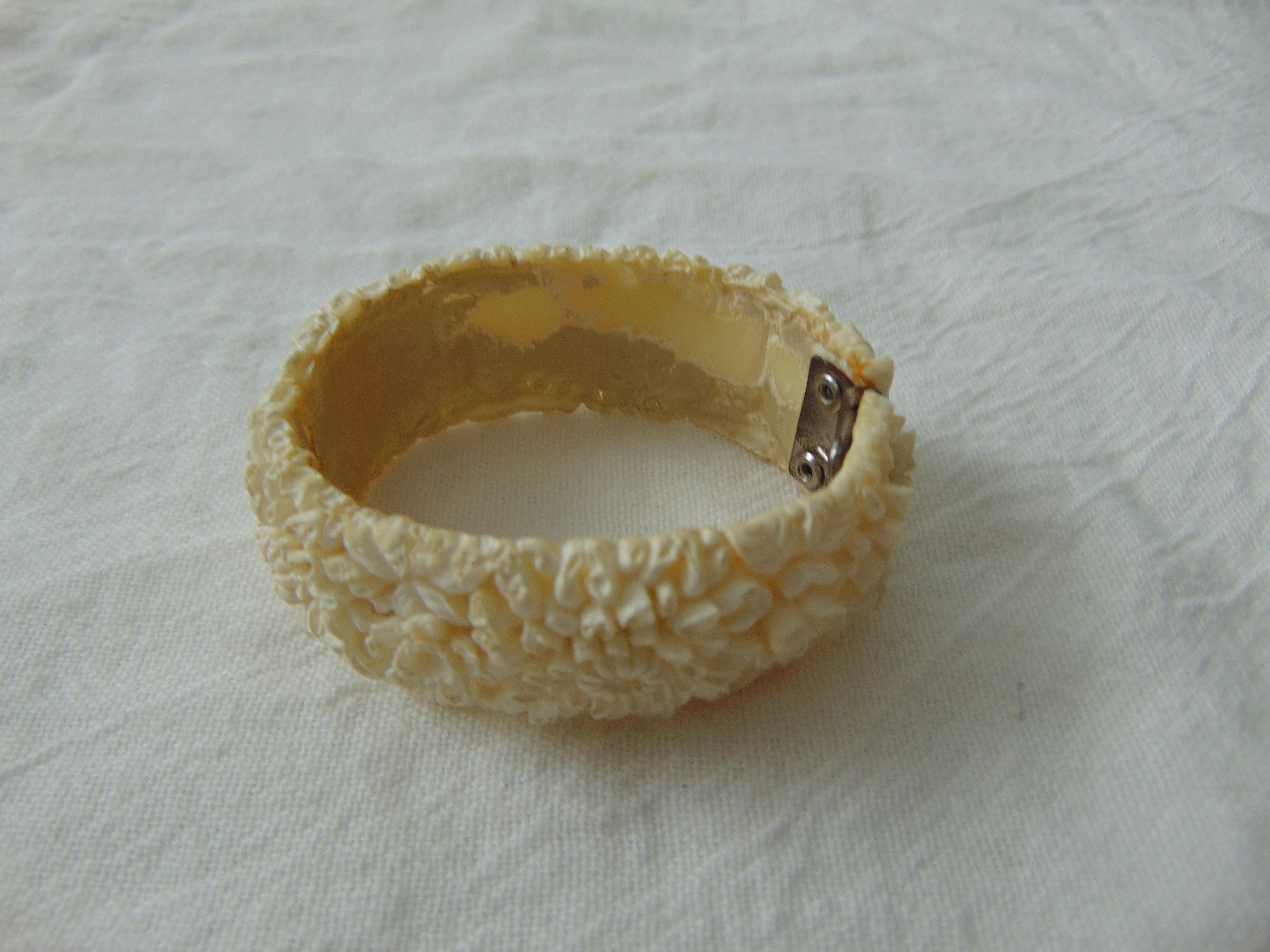 1950's white floral molded plastic clamp bangle