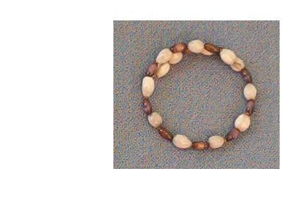 Bracelet with white Jobs Tears and brown cats eye rice beads