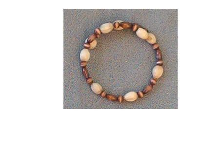 Bracelet with white Jobs Tears and brown cats eye beads