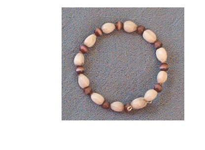 Bracelet with white Jobs Tears and brown round cats eye beads