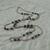 vintage Monet signed mottled gray plum bead stations silver sautoir necklace