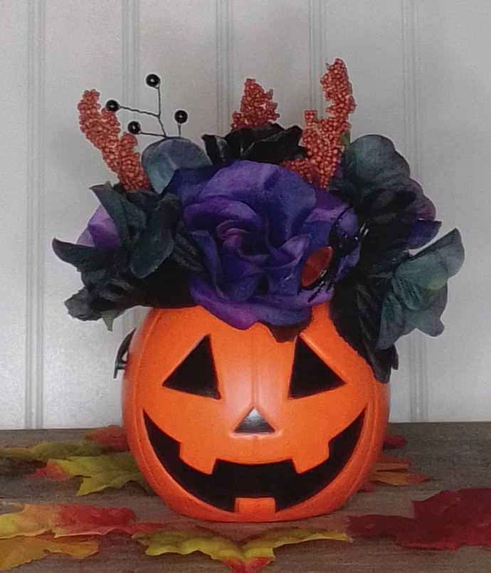 Small Halloween silk floral arrangement in a small trick or treat pail