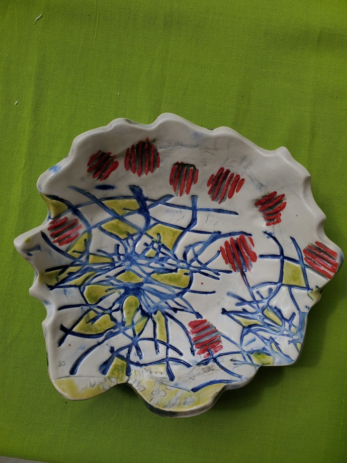 "Hand painted clay platter with wavering lip. 9"" diameter, 2 1/2 "" tall"