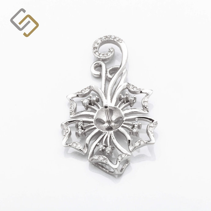 Floral Pendant with Cubic Zirconia Inlays and Cup and Peg Mounting and Bail in