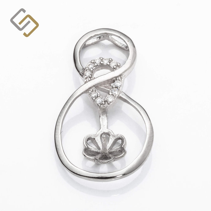 Figure 8 Pendant with Cubic Zirconia Inlays and Cup and Peg Mounting in Sterling