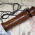 Heavily grained exotic wood hand-turned pocket game call or squawker