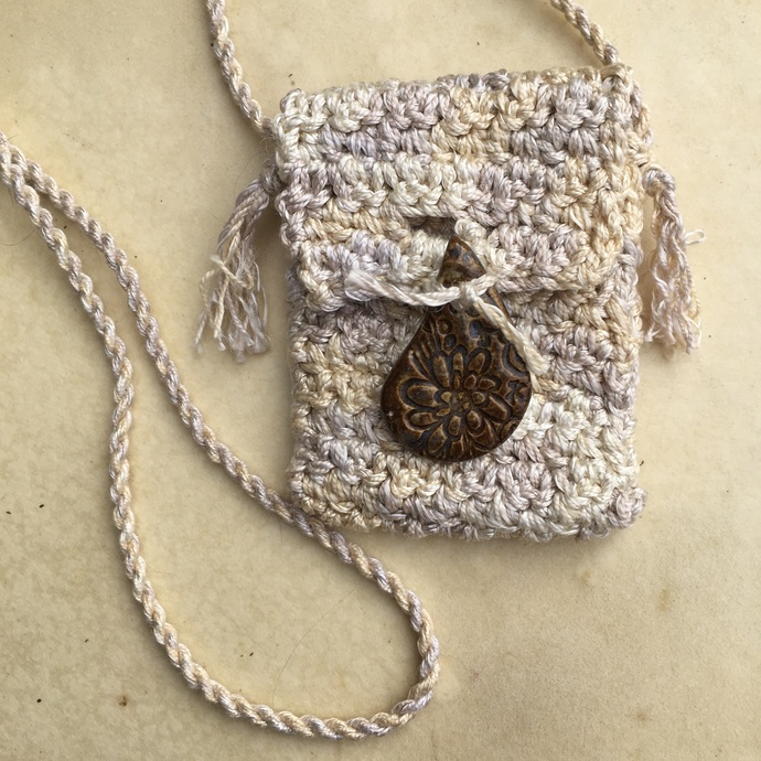 """Overflow"" Spirit Pouch - crocheted, with a handmade ceramic button"