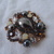 vintage Chicos hematite topaz clambroth opaque clear crystals brooch