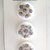 White Glass Buttons with Gray and Gold Splatter Pattern