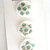 White Glass Buttons with Green and Gold Splatter Pattern