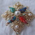 vintage Sarah Coventry signed gold tone ab crystals pearls colored stones brooch