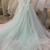 mint green floral lace flutter sleeve ball gown wedding dress with court