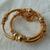 vintage gold bead tassel coil bangle bracelet / arm cuff