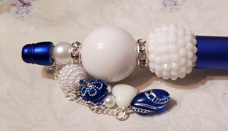 Dark blue and white hand beaded pen set