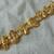 vintage matte gold Christmas themed bracelet nos