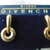 Givenchy signed gold doorknocker style earrings pierced nos mint