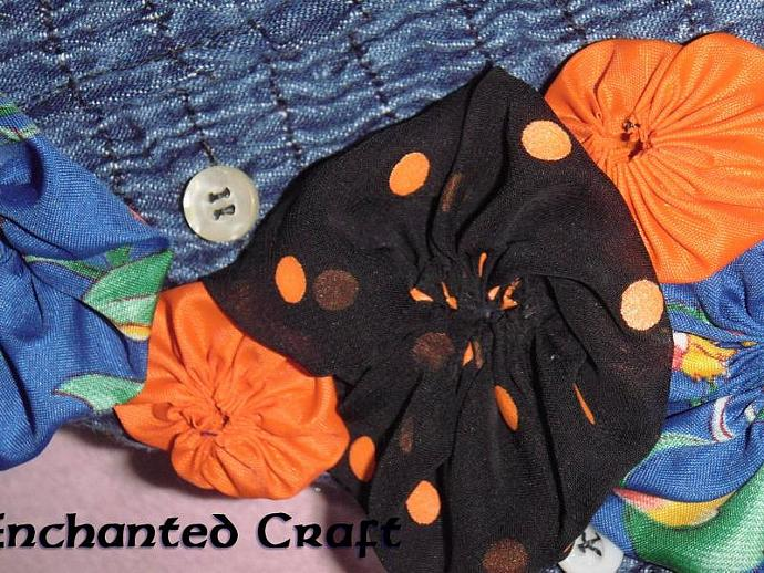 Designer Upcycled Denim Purse with outside pocket and flowers!