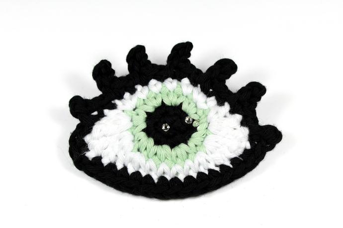 Crochet eye brooch with Swarovski crystals - Light mint green