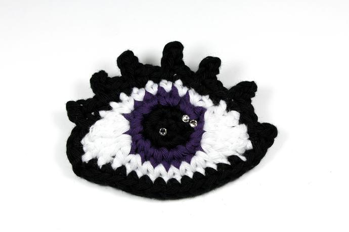 Crochet eye brooch with Swarovski crystals - Purple