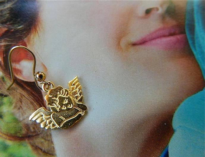 Matte  gold  tone  cherub  earrings