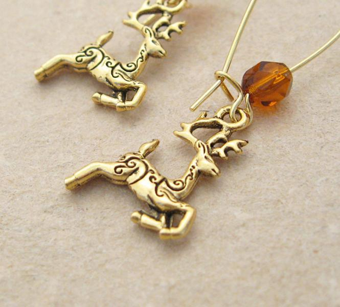 Golden Reindeer earrings: gold deer charms with brown Czech glass