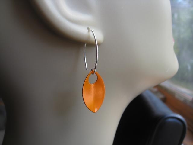 sterling silver earrings in burnt orange. modern leaf earrings in pumpkin.