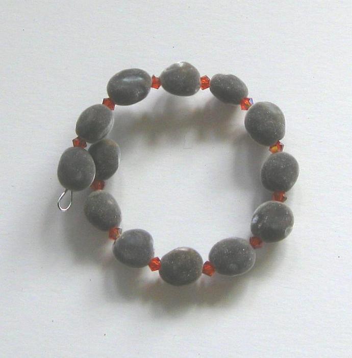 Bracelet: Hawaiian mgambo seed and Indian Red AB Swarovski crystals