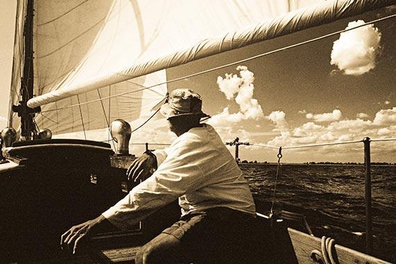 A Clasic Sailboat With an Old Man at Tiller Photo Art A Sailing Art