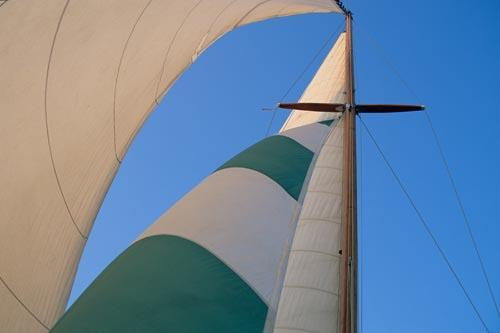 Colorful Head Sails of a Classic Wooden Sailboat